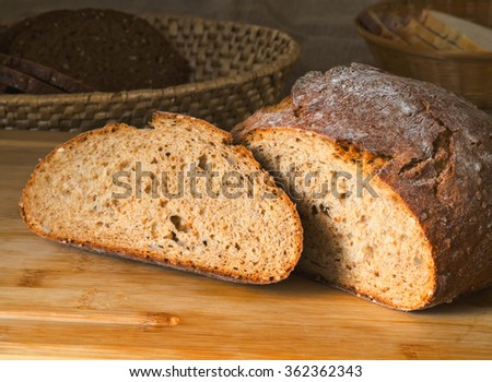 Sourdough bread on wooden plank still life  - stock photo
