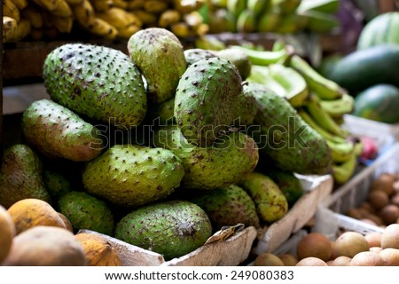 Soursop fruit at asian market, Philippines. Annona muricata in assortment on sale - stock photo