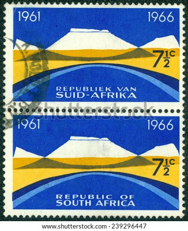 """SOUTH AFRICA - CIRCA 1965: stamp printed in South Africa from the """"5th anniversary of the Republic. Bilingual pairs"""" issue shows Mountain landscape, circa 1965. - stock photo"""