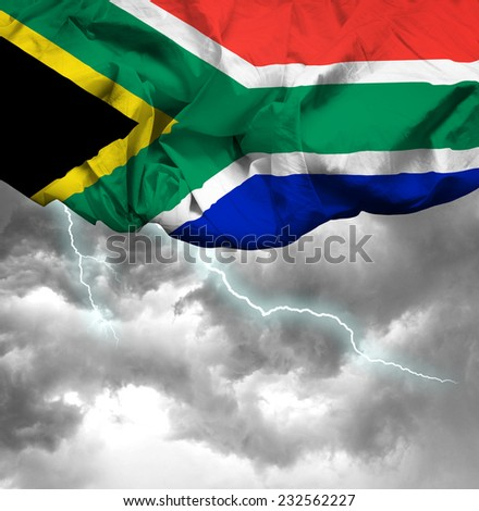 South Africa waving flag on a bad day - stock photo