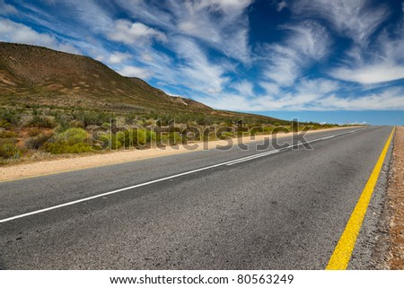 South African, lonely road or highway with a vision - horizontal - stock photo