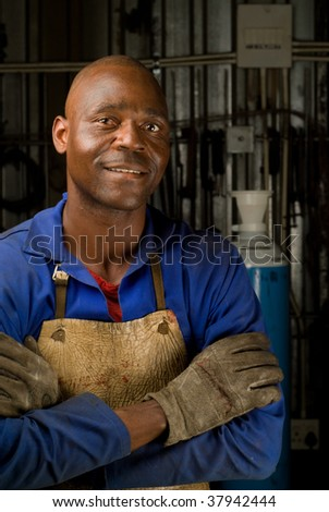 South African or American welder worker - stock photo