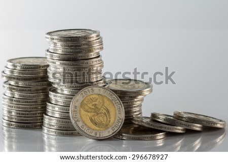 south african reserve bank silver minted coins in a pile against a white background - stock photo