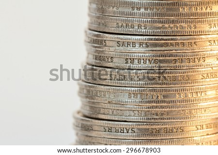 south african silver minted coins in a pile against a warm golden white background showing edge detail - stock photo