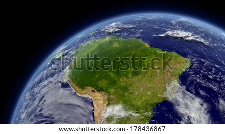 South America viewed from space with atmosphere and clouds. Elements of this image furnished by NASA. - stock photo