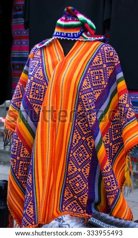 South American colorful poncho and hat, Peru. Traditional patterns and design. - stock photo