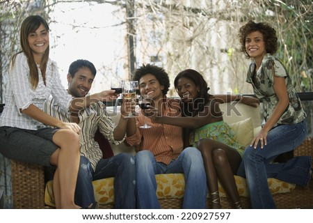 South American friends toasting at party - stock photo