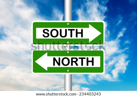 South and North Road Sign with a blue sky in a background - stock photo