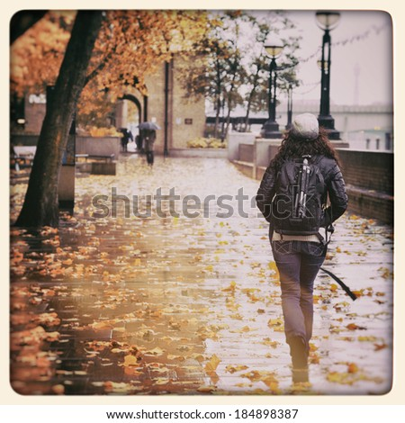 South Bank in the rain in autumn, London, UK. Filtered to look like an aged instant photo. - stock photo