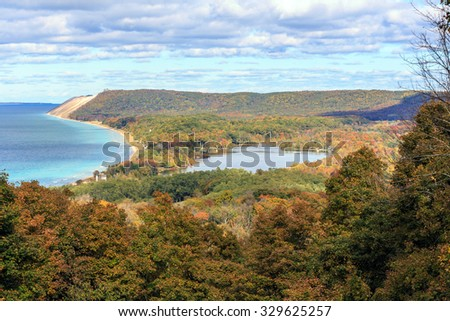 South Bar Lake and Lake Michigan, as seen from Empire Bluff Trail. This plateau, part of Sleeping Bear Dunes is a dominant part of the scene. South Manitou Island can be seen in the distance. - stock photo