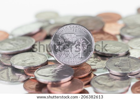 South Carolina State Quarter coin with other coins extreme close up - stock photo