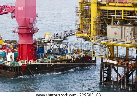 SOUTH CHINA SEA, BRUNEI - JANUARY 26: A crane of Ampelmann  on deck of a vessel on January 26, 2014 in Brunei. This system allows a safe access to offshore structures, even in high wave conditions - stock photo