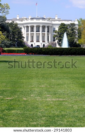 South facade and South lawn of the White House in Washington DC in spring colors, with vertical copyspace on the fresh green lawn - stock photo