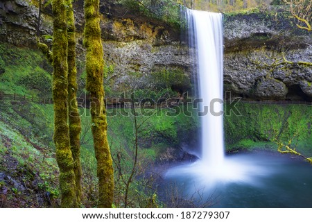 South Falls at Silver Falls Park in Oregon with water falling into a pond done with slow exposure - stock photo
