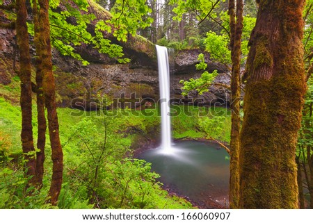South Falls in Silverton Springs State park spills over 160 feet and has a trail wrapping behind the falls. - stock photo