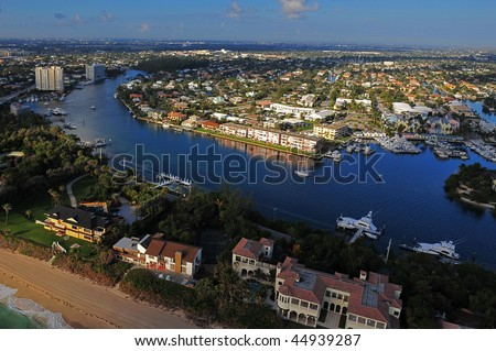 south florida intracoastal waterway community and atlantic ocean beach, aerial view - stock photo