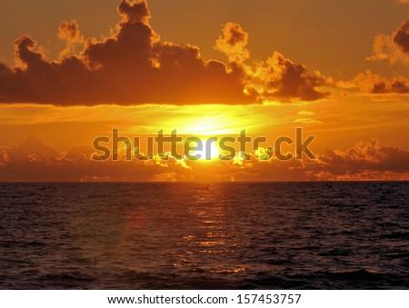 South Florida sunrise from Ft Lauderdale/ Peeking Sunrise - stock photo