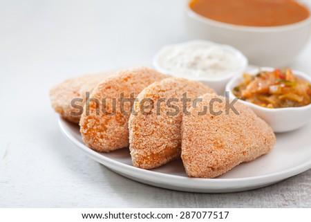 South Indian dish. Fried Idli with coconut chutney tomato upma and sambar - stock photo