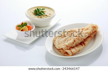 South Indian dish  Parotta with vegetable curry - stock photo