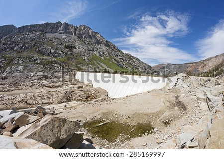 South Lake Dam with a nearly empty South Lake in the Sierra Nevada in California - stock photo