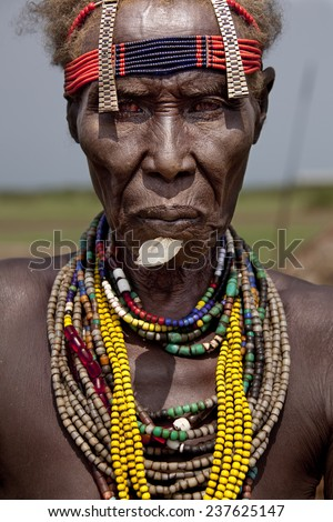 SOUTH OMO - ETHIOPIA - NOVEMBER 23, 2011: Portrait of the unidentified old woman from the African tribe Dasanech, in November 23, 2011 in Omo Rift Valley, Ethiopia. - stock photo