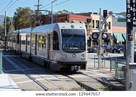 SOUTH PASADENA, CA - FEBRUARY 25 : A Gold Line AnsaldoBreda P2550 train enters Mission Station in South Pasadena on February 25, 2012.  The train seats 76 people and has a top speed of 65 mph. - stock photo