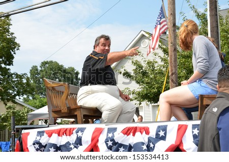 SOUTH PLAINFIELD,NJ-SEPTEMBER 2: New Jersey Governor Chris Christie points to a parade-goer during the 56th Annual Labor Day Parade on September 2,2013 in South Plainfield,N.J. - stock photo
