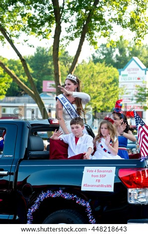 SOUTH ST. PAUL, MINNESOTA - JUNE 24, 2016: Mrs. Minnesota waves to crowd from motorcade at annual South St. Paul Kaposia Days Grande Parade on June 24.  - stock photo