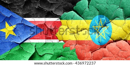 south sudan flag with Ethiopia flag on a grunge cracked wall - stock photo