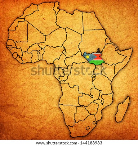 south sudan on actual vintage political map of africa with flags - stock photo