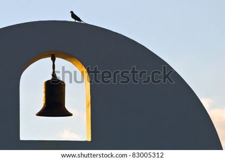 south western white mission building with bell and dove bird on blue sky background - stock photo