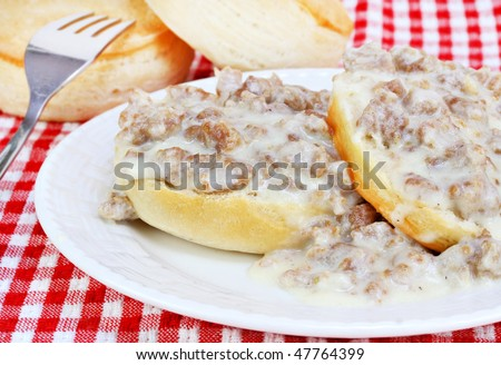 Southern biscuits, sausage and gravy. - stock photo