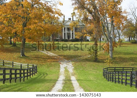 Southern home in historic horse country of Lexington Kentucky in autumn - stock photo