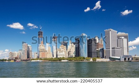 Southern tip of Manhattan with the Financial District as seen from a boat in New York harbor in New York, NY, USA. - stock photo
