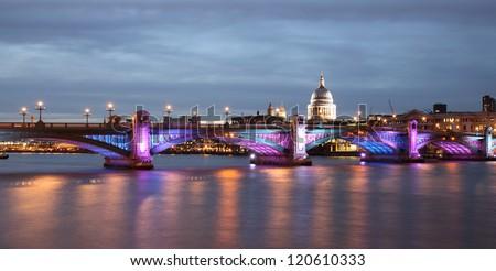 southwark bridge illuminated in the evening - stock photo