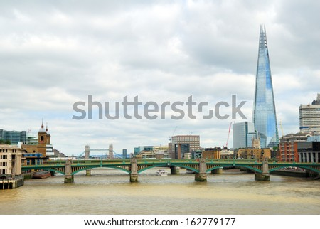 Southwark bridge with the Tower bridge and skyscraper - stock photo