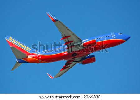 Southwest Airlines airplane after take off with blue sky - stock photo