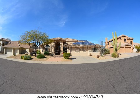 Southwestern Ranch Style House With Rooftop Solar Panels - stock photo