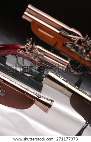 Souvenir antique pistols in an interesting photocomposition - stock photo