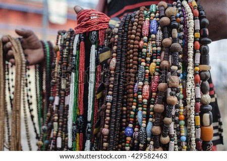 Souvenir beads made of colorful semi-precious stones - stock photo