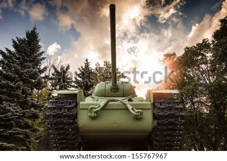 Soviet heavy KV-85 tank from the Second World War with forest and dramatic sky on a background. Monument in St-Petersburg - stock photo