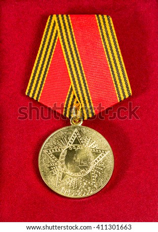 Soviet medal in honor of the anniversary of victory in World War II - stock photo