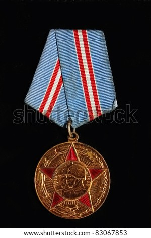 Soviet medal, 50 years of Soviet armed forces in USSR. - stock photo