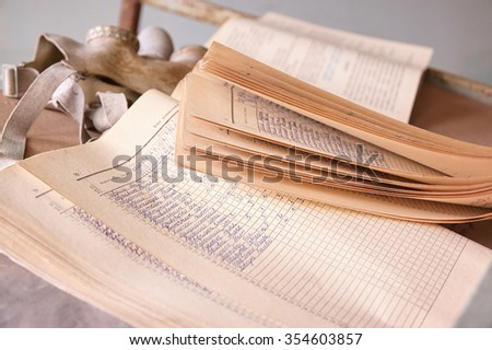 soviet time hand written school attendace journal and gaz mask on the table  in one of Chernobyl schools. - stock photo