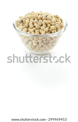 soy bean, soybean in glass cup on white background. - stock photo