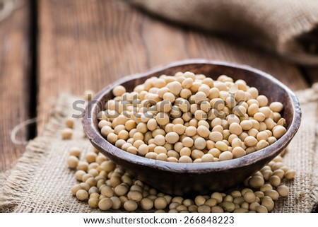 Soy Beans (detailed close-up shot) on wooden background - stock photo