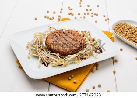 Soy hamburger with soy sprouts - stock photo