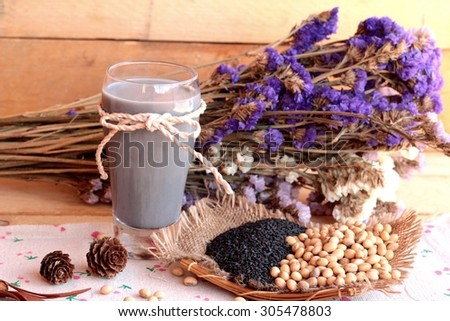 Soy milk mix black sesame with soybean seed and black sesame seeds dry - stock photo