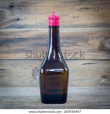 soy sauce bottle on wood. - stock photo