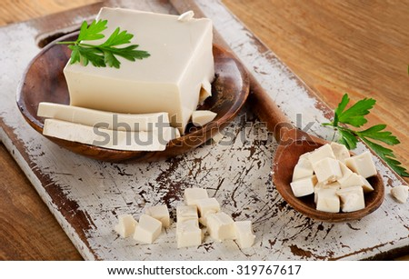 Soy Tofu on a wooden table. Selective focus - stock photo